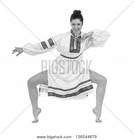 colorless full length portrait of dancing girl in polish national traditional costume, isolated over white background