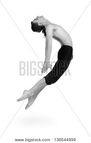 colorless portrait of young and stylish modern ballet dancer jumping, isolated over white background