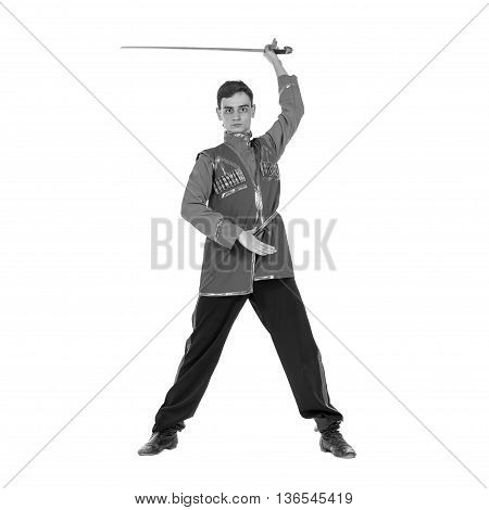 colorless full length portrait of Russian cossack dance. Young dancer in ethnic clothes posing with sword, isolated over white background