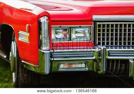 MINSK BELARUS - MAY 07 2016: Close-up photo of the red Cadillac Eldorado 1976 model year. Headlights of vintage car.