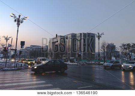 BUCHAREST, ROMANIA - January 22, 2016: The area near Bucharest Courthouse from Unirii Boulevard at rush hour. BUCHAREST - January 22 2016