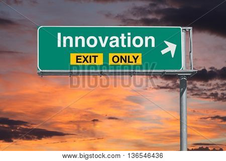 Innovation exit only freeway sign with sunrise sky.