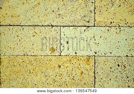 Abstract Yellow brick building wall background texture