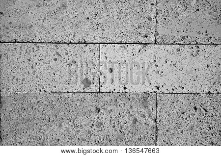 Abstract black and white brick building wall background texture