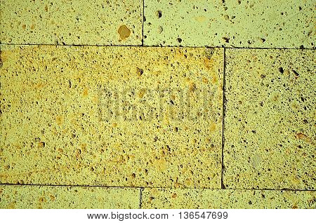 Abstract Yellow building brick wall background texture