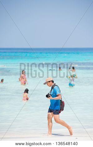 PANG-NGA THAILAND-2MAR2015:Photographer man walking on the beach at koh tachaipang-nga thailand on 2 march 2015