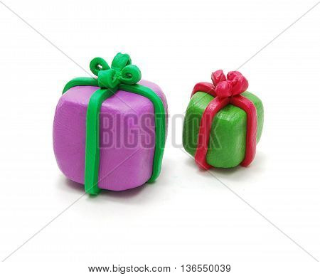 Two 3D Colored Christmas Gifts Made of Plasticine Isolated on White Background