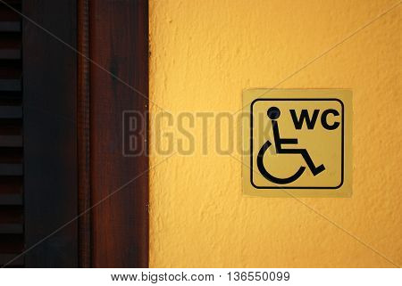 Invalid Lavatory Label on the Yellow Wall near the Door