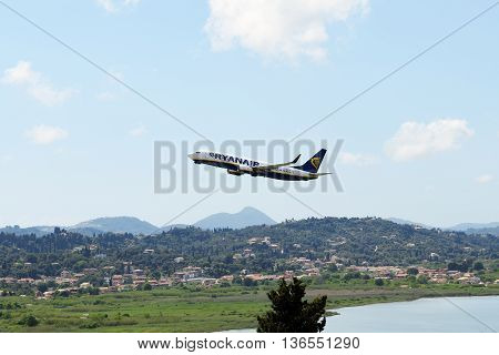 KERKYRA GREEES - MAY 14: The aircraft of Ryanair Airlines taking off in Corfu International Airport on May 14 2016 in Kerkyra Greece. Up to 16 mln tourists is expected to visit Greece in year 2016.