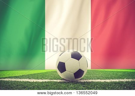 Italy waving flag and soccer ball on grass vintage color