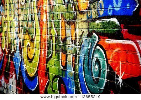 A smart graffiti tag on a brick wall