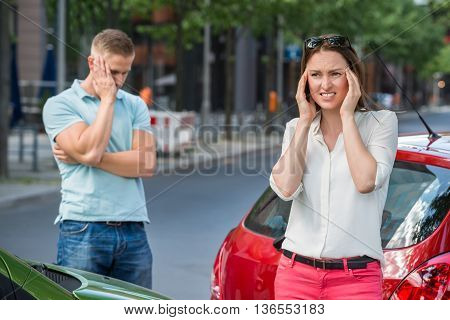 Worried Man Standing Behind Woman Suffering From Head Pain