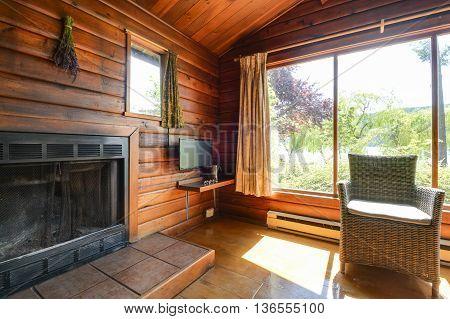 Cozy interior of a rustic log cabin.