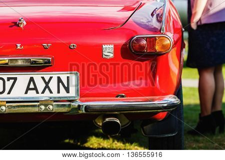 MINSK BELARUS - MAY 07 2016: Close-up photo of red Volvo P1800. Back view of retro classic vintage car. Selective focus.