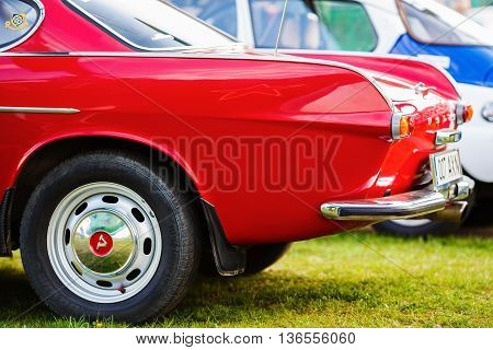 MINSK BELARUS - MAY 07 2016: Close-up photo of red Volvo P1800. Close-up of the rear of vintage car. Selective focus.