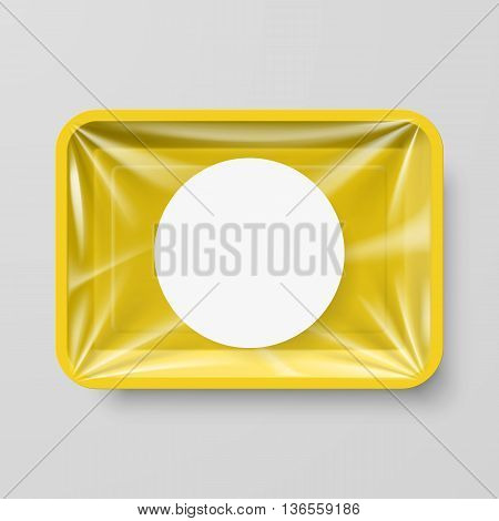 Empty Yellow Plastic Food Container with Round Label