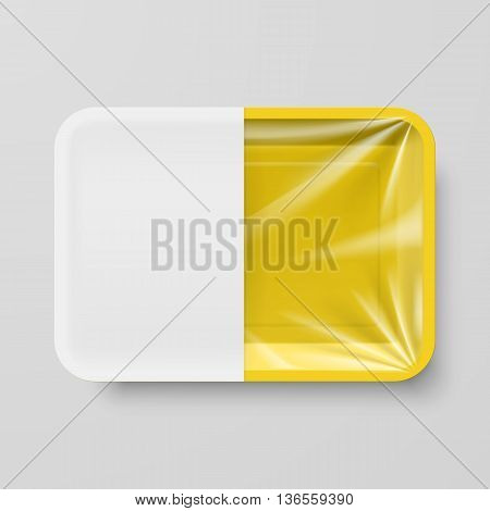 Empty Yellow Plastic Food Container with White label on Gray Background