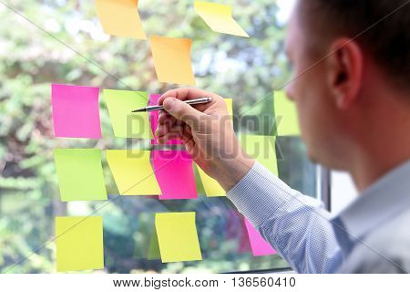 business man working with stickers in office