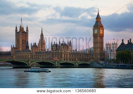 LONDON, UK - JULY 21, 2014: Big Ben and Houses of Parliament at sunset and first night lights