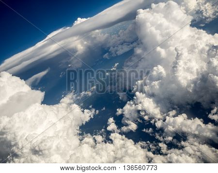 Cumulus and stratus clouds, horizontal but tilted view, seen from airplane