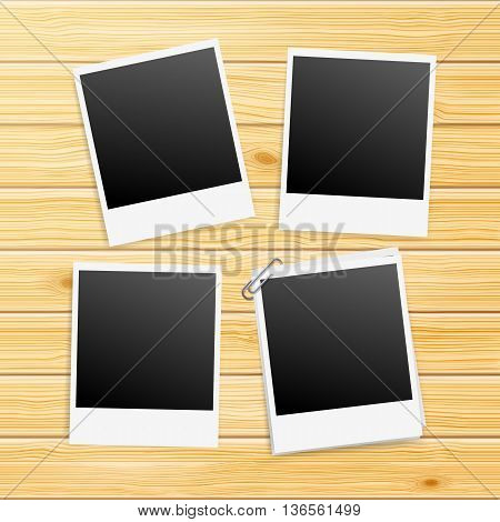 Photo Frames on Yellow Wooden Background with Paperclip