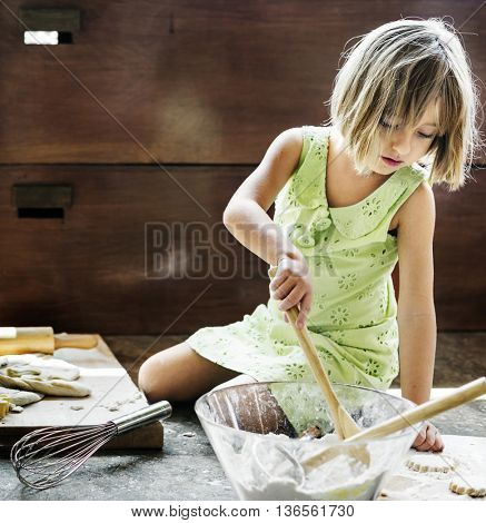 Little Girl Baking Cookies Concept
