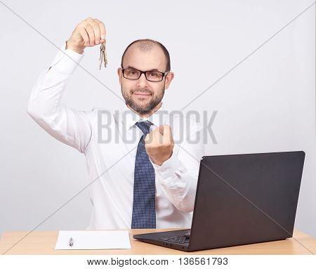 Man Realtor Offering Keys