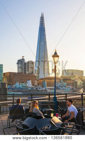 LONDON, UK - APRIL 15, 2015:  City of London and Shard of glass building. View from the South bank of the river Thames at sunset.