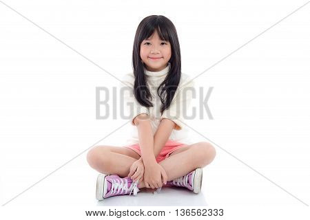 Beautiful asian girl sitting on white background isolated
