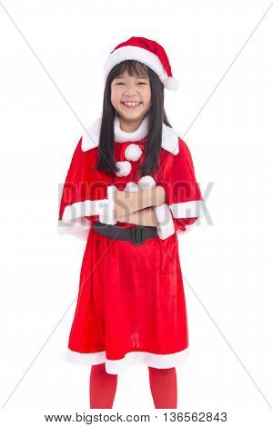 Beautiful asian girl wearing Santa Claus uniform on white background isolated