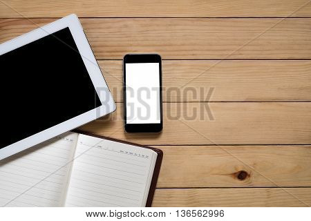 Office stuff with blank screen tablet blank screen smartphone and leather notebook top view with workspace.Flat lay image