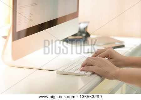 Woman's hands or men office worker typing on the keyboard