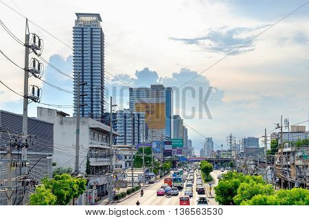 Bangkok Thailand - June 22 2016: Traffic moves slowly along a busy road in Bangkok Thailand. Annually an estimated 150000 new cars join the already heavily congested streets of Bangkok.