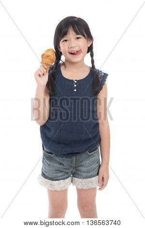 Cute asian girl eating fried chicken on white background isolated