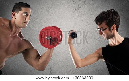 Boys are confronted by lifting a dumbbell weights