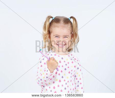 Little Girl Brushing Her Teeth.