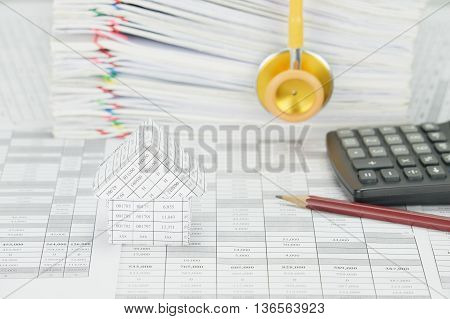 House Have Blur Gold Stethoscope And Pile Paperwork As Background
