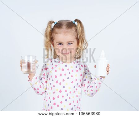 Little Girl Holding Filter For Drinking Water And  Glass Of Clean Water.
