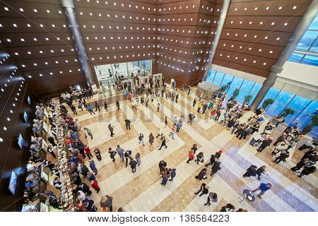 MOSCOW, RUSSIA - APR 24, 2015: People in cafeteria in lobby of Crocus city hall. Crocus City Hall is a concert hall administratively located in Krasnogorsk Urban Settlement.
