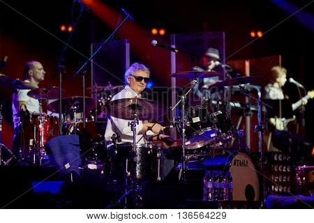 MOSCOW, RUSSIA - APR 24, 2015: Drummer A.Murashov in concert on stage of Crocus city hall at Secret band show. Rock and roll band Secret founded in 1982 in Leningrad.