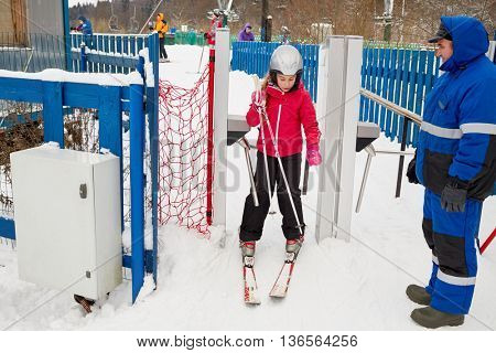 MOSCOW REGION, RUSSIA - DEC 28, 2014: Girl (with model release) equipped for skiing at turnstile at Sports complex Stepanovo. Sports complex Stepanovo is located 50 km from Moscow.