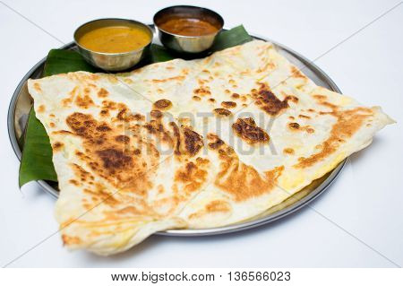Indian tray meal with bread and sauce