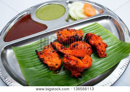 Indian tray food meal of fried pork