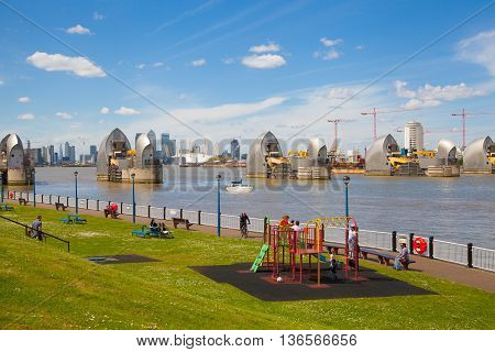 London, UK - May 4, 2015: London barrier on the River Thames view and park with children's playground