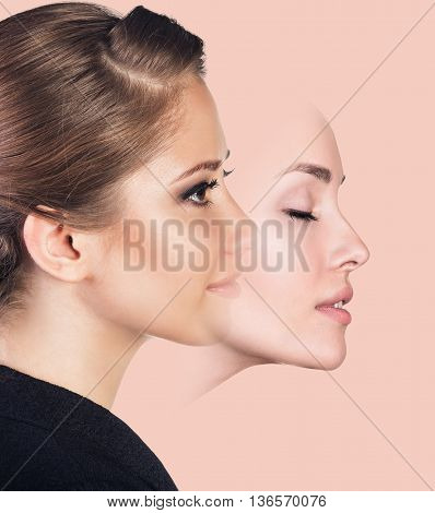 Young woman taking off a mask over pink background
