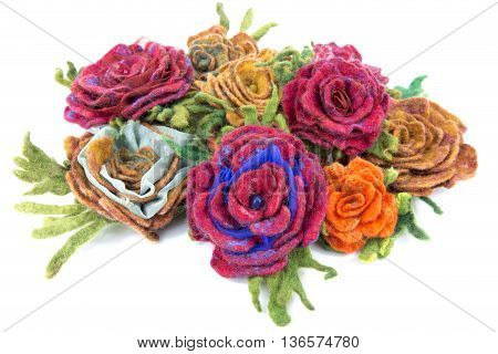 Brooch of fulled wool in the form of flowers on a white background
