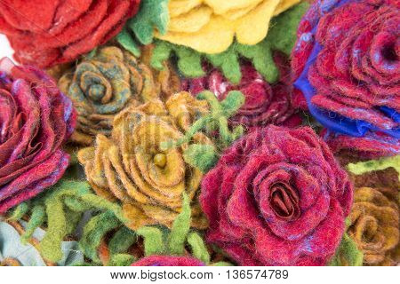 Brooch of fulled wool in the form of flowers closeup