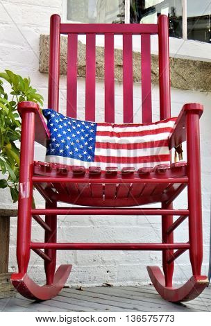 American flag pillow and red rocking chair
