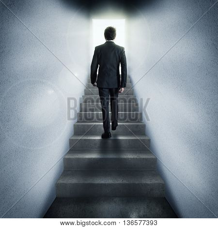Businessman climbs stairs to a passage lit