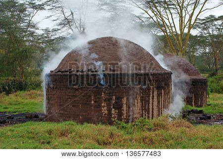 African hut for the production of charcoal Kenya